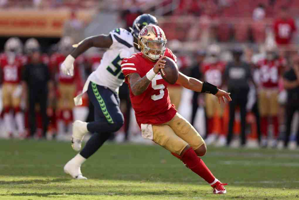 Trey Lance #5 of the San Francisco 49ers scrambles with the ball during the second half against the Seattle Seahawks at Levi's Stadium on October 03, 2021 in Santa Clara, California.