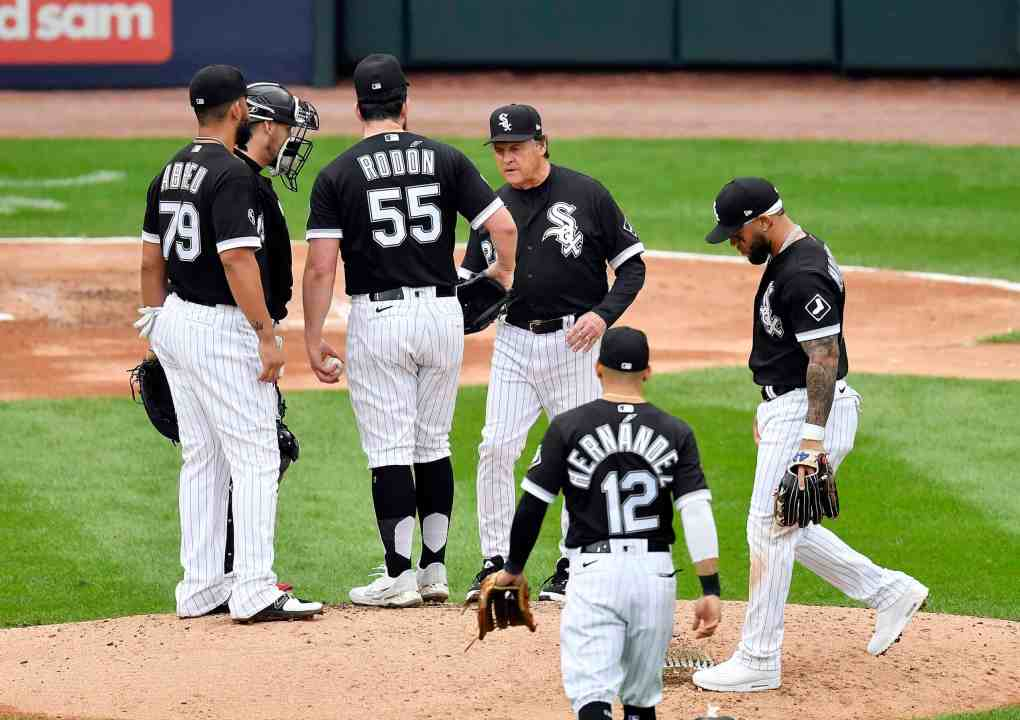Manager Tony La Russa #22 of the Chicago White Sox relieves starting pitcher Carlos Rodon #55 during the 3rd inning of Game 4 of the American League Division Series against the Houston Astros at Guaranteed Rate Field on October 12, 2021 in Chicago, Illinois.