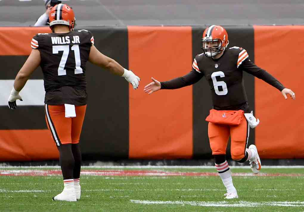 Jedrick Wills #71 and Baker Mayfield #6 of the Cleveland Browns high five in the first quarter against the Pittsburgh Steelers at FirstEnergy Stadium on January 03, 2021 in Cleveland, Ohio.
