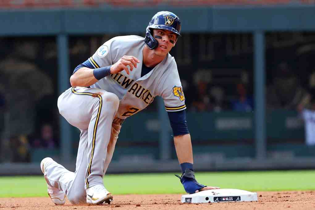 Christian Yelich #22 of the Milwaukee Brewers slides into second base during the fourth inning in game 3 of the National League Division Series at Truist Park on October 11, 2021 in Atlanta, Georgia.