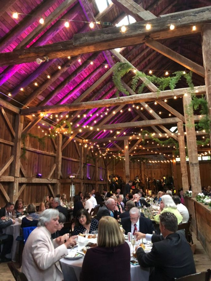 Lovely barn uplighting - unlimited color choices for your wedding reception