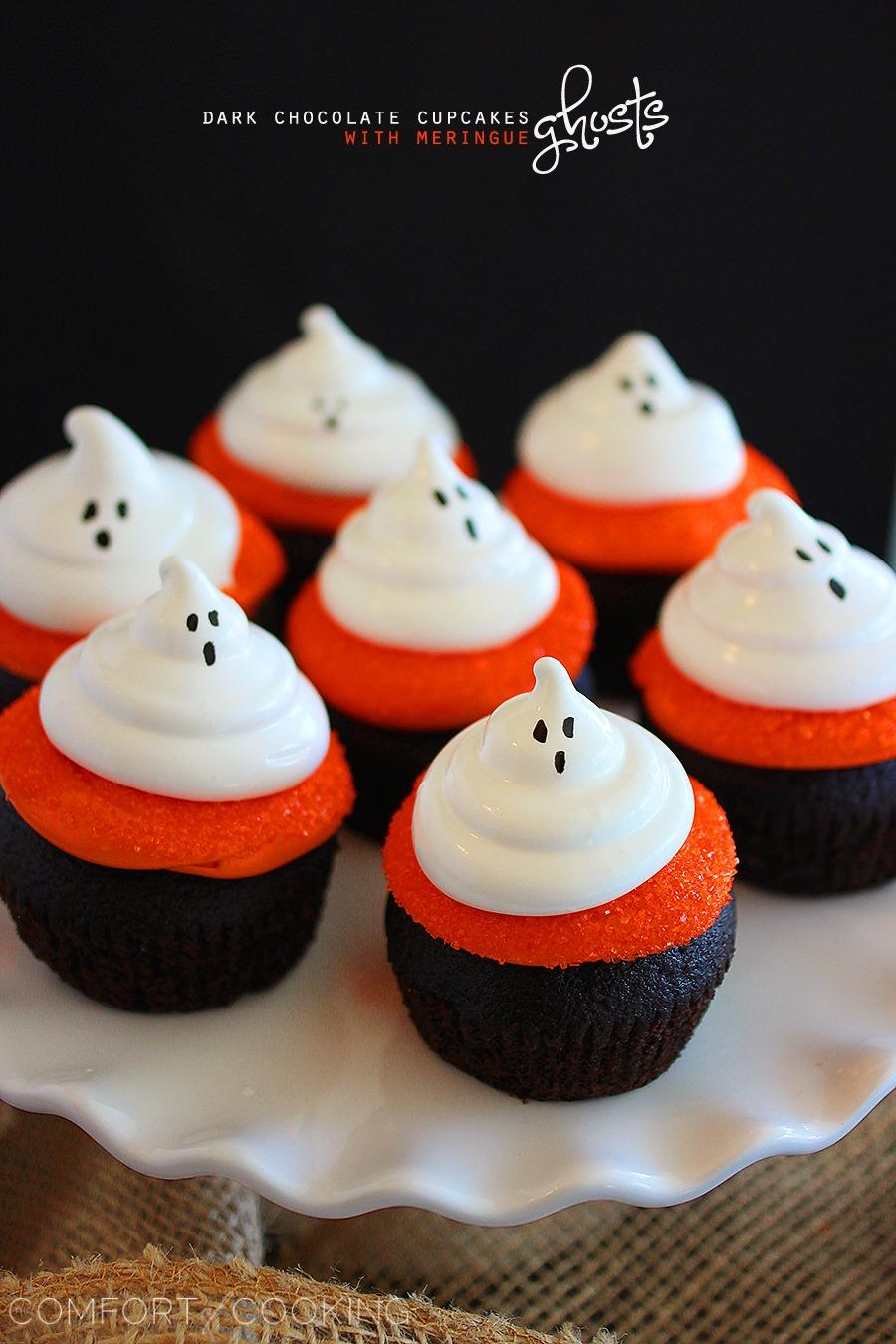 Dark Chocolate Cupcakes with Meringue Ghosts – Decadent dark chocolate cupcakes with fluffy meringue ghosts make for a scrumptious, spooky Halloween treat!   thecomfortofcooking.com