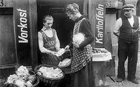 A German woman in the 1923 Weimar Republic purchasing a loaf of bread. This time is almost upon the American people.