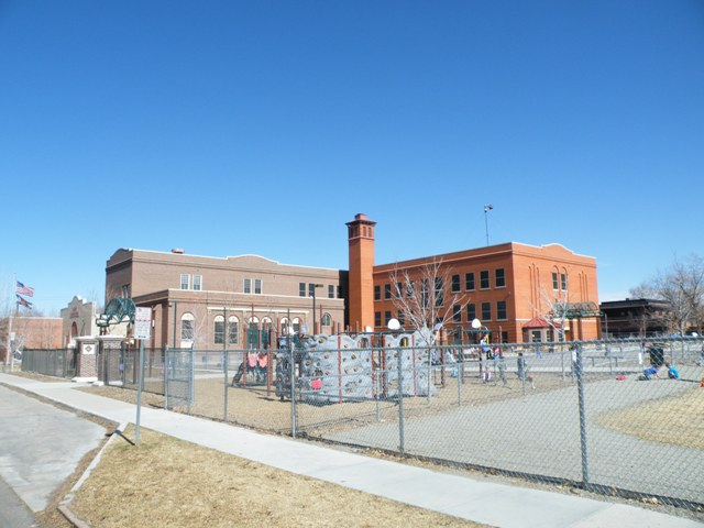 Prison fencing and a guard tower at this Denver Public School.