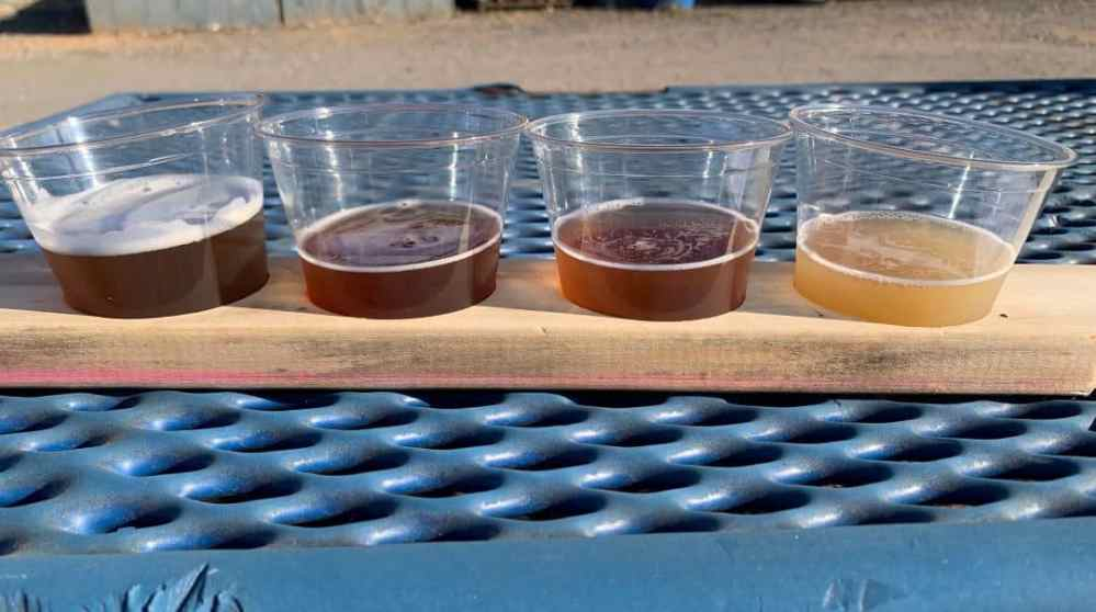 Ridgeline Craft Beverage Trail featured by top NC travel blog, The Common Traveler:  flight of beers at Ole Dallas Brewery on the Ridgeline Craft Beverage Trail