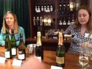 Bar two women serving sparkling wines