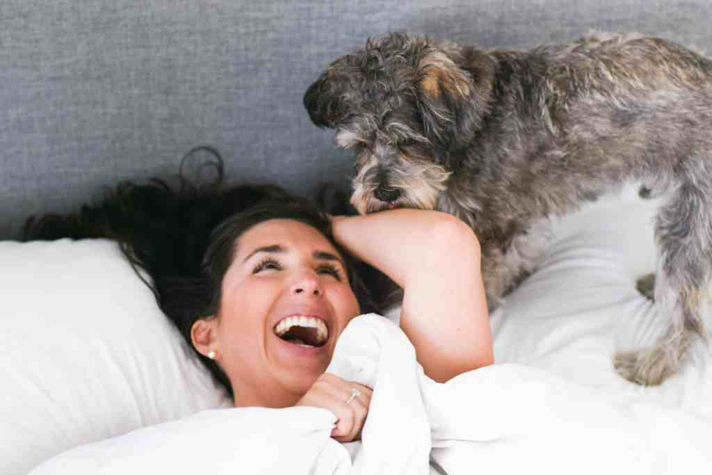 millennial blogger laughing with dog