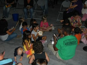 Children in a Circle Drumming