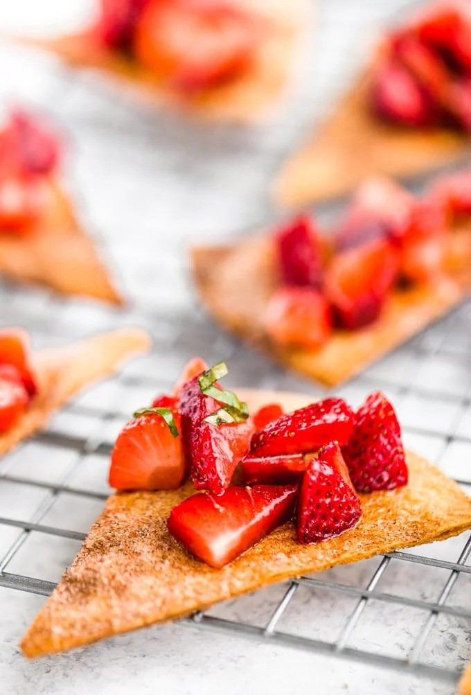 Homemade cinnamon tortilla chips topped with strawberry basil salsa
