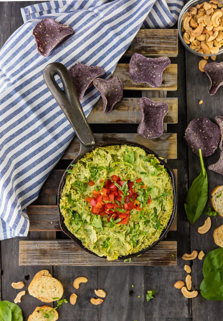 VEGAN SPINACH ARTICHOKE DIP! You won't even miss the cheese and dairy. SO FLAVORFUL and easy!! My husband didn't even notice it was a vegan recipe!!