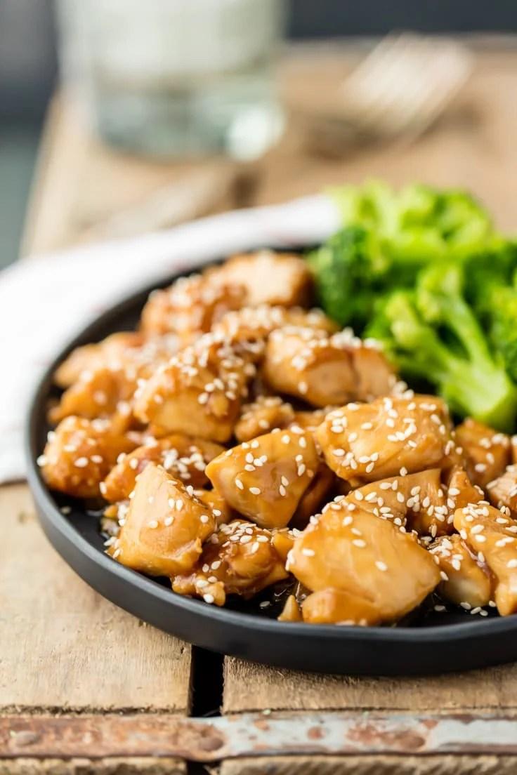 a plate of chicken teriyaki with broccoli