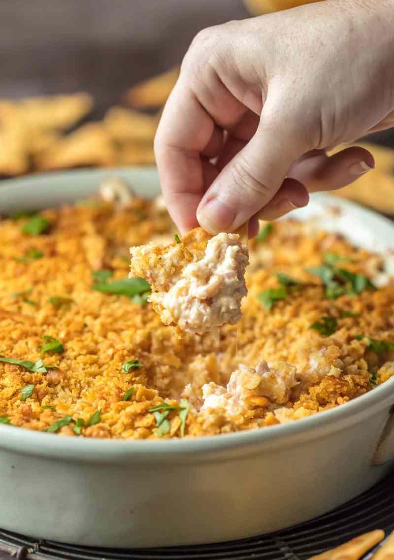 Dipping a cracker into chicken cordon bleu dip