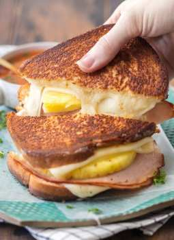 Hawaiian Pizza Grilled Cheese is my favorite Grilled Cheese Recipe for busy days and nights. Tips and tricks for how to make the PERFECT Grilled Cheese included in this delicious sandwich loaded with cheese, ham, and pineapple. This Pizza Grilled Cheese is a delicious twist on a classic recipe loved by both kids and adults!