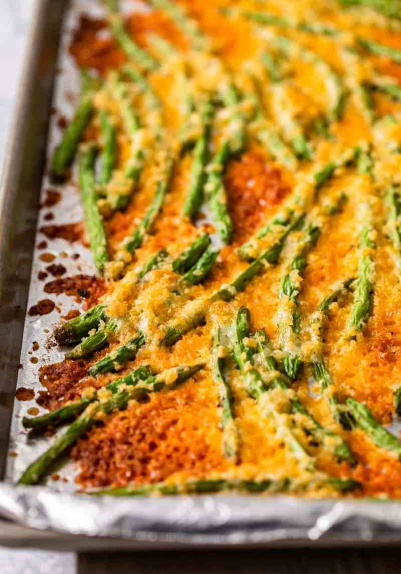 close up of crispy baked green beans in cheese