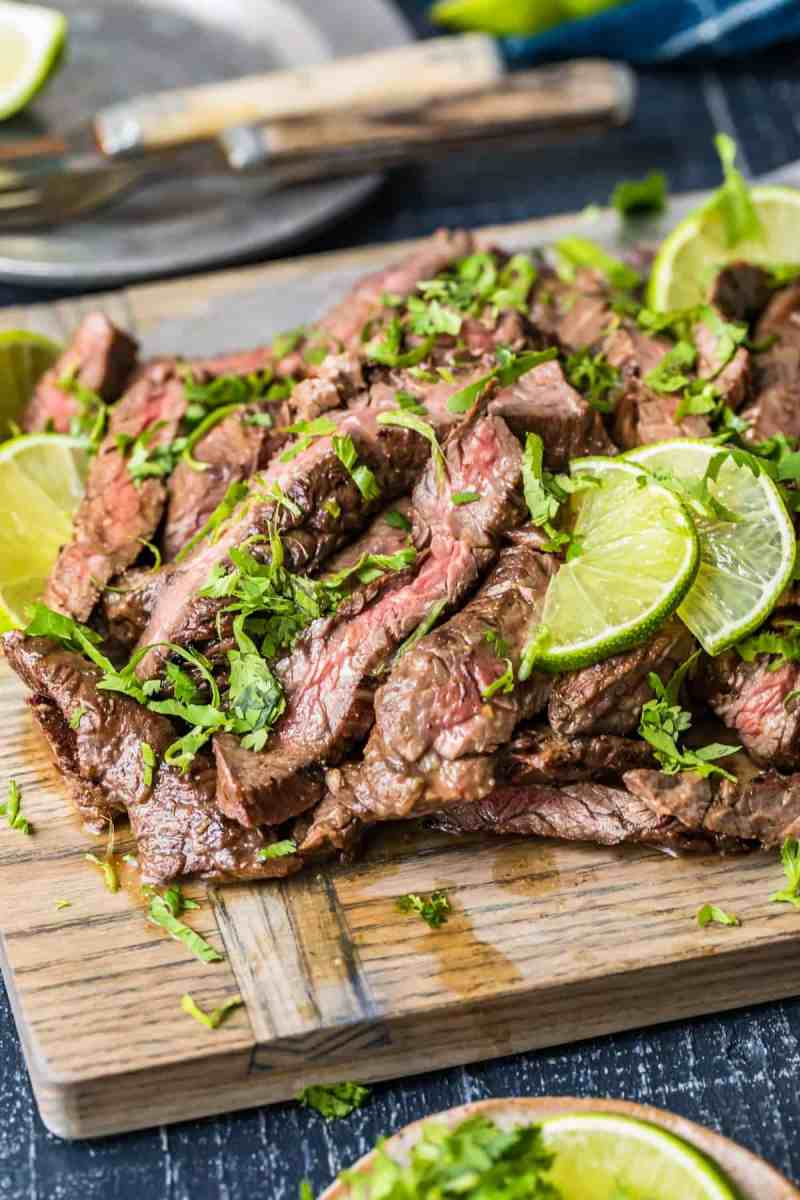 Carne Asada Steak sprinkled with fresh herbs and lime slices