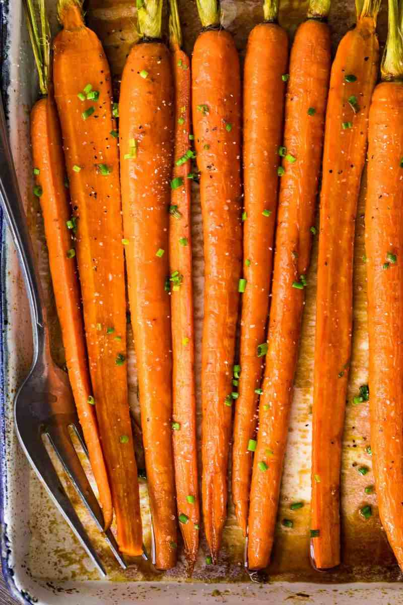 Brown Butter Glazed Carrots sprinkled with a green garnish