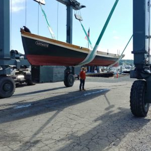 Flagship Forwarding LLC successfully ships a 38 bantry bay wood row boat