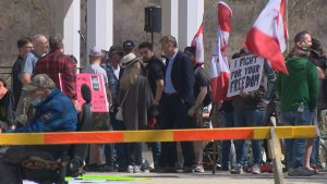Close to 100 people attend Saskatoon anti-mask rally