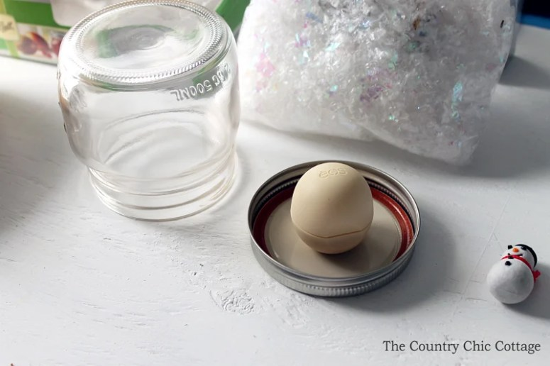 Make an EOS lip balm snow globe as a gift this holiday season! Everyone will love these Christmas gifts!