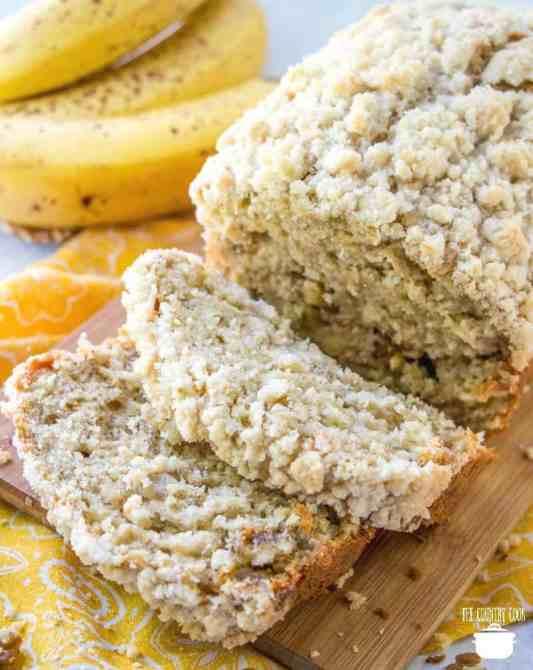 sliced banana nut bread with ripe bananas