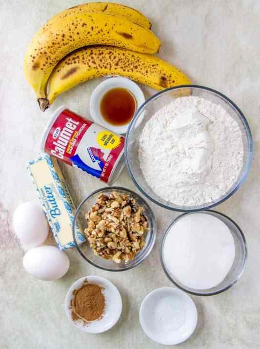 ripe bananas, flour, butter, eggs, cinnamon, vanilla extract, walnuts, baking powder