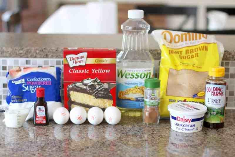yellow boxed cake mix, brown sugar, eggs, sour cream, oil, honey, cinnamon, vanilla extract, powdered sugar