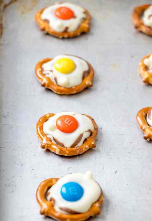 cooled pretzel bites on top of cookie sheet