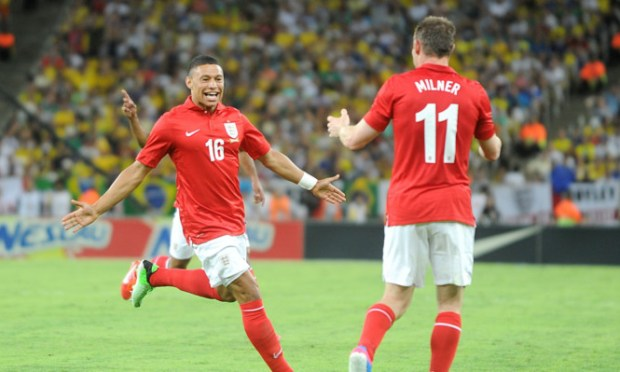 England's Alex Oxlade-Chamberlain (left) celebrates scoring England's first goal.