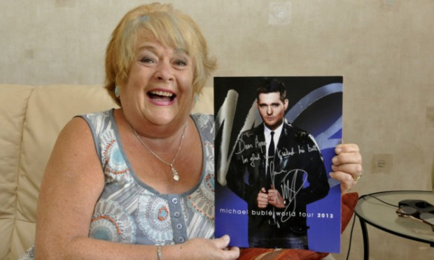 Agnes with her signed Michael Buble programme.