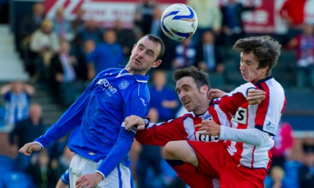 St Johnstone's Dave Mackay does well to clear under pressure from Paul Heffernan (centre) and Chris Johnston (right).
