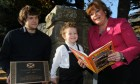 Gavin Downie, who designed the plaque, with Fiona Hyslop and Jamie Webster, 5, dressed as Oor Wullie.