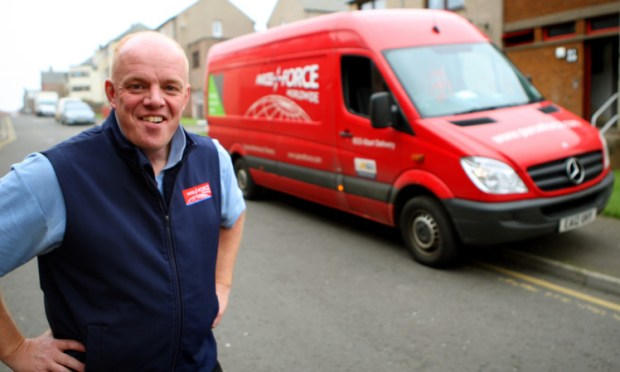 Brian rescued the woman from a burning building while out delivering for Parcelforce.