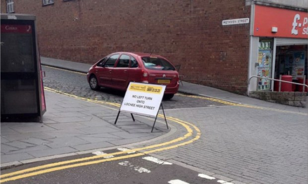 A sign warning motorists of the changes to Lochee High Street.
