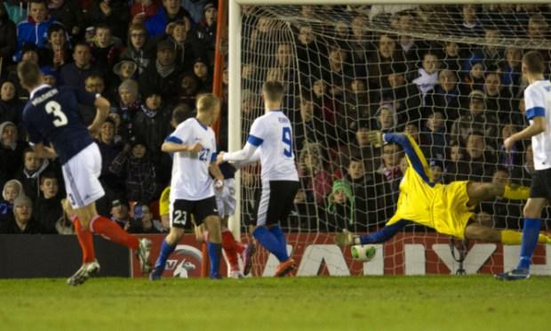 Estonia keeper Sergei Pareiko fails to keep out Charlie Mulgrew's shot as Scotland take the lead.