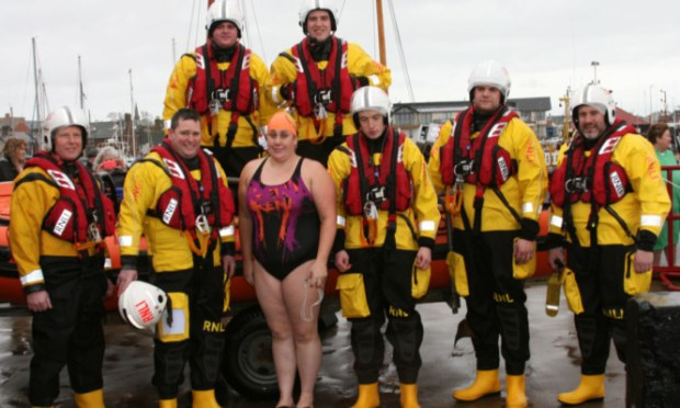 Colleen Blair with members of the Arbroath Lifeboat Crew after the dook in Arbroath.