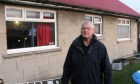 Jim Hayter outside his house at Sidlaw View Primary School.