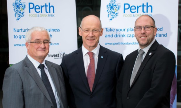 from left Perth and Kinross Councils convener of enterprise and infrastructure John Kellas, John Swinney MSP and David Littlejohn, the councils head of planning and regeneration.