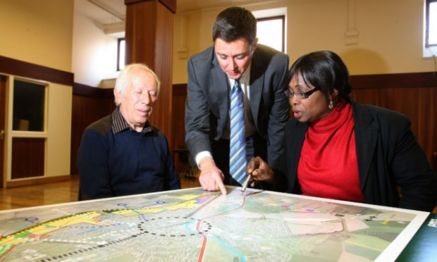 Community Council members Peter Cura and Loretta Mordi discuss plans for Cupar North with land manager Gordon Johnson at Octobers public consultation at the Corn Exchange in the town.