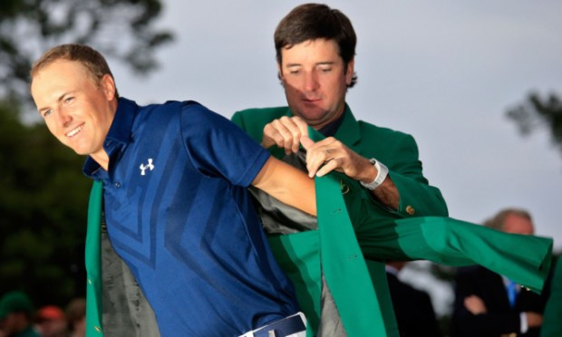 Former champion Bubba Watson presents Jordan Spieth with the green jacket.