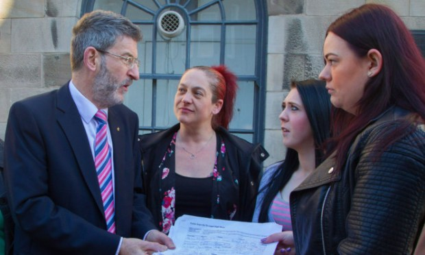 Nigel Don receives the petition from, from left, Nikki Leasley, Adele Speirs and Bobbi Murray.