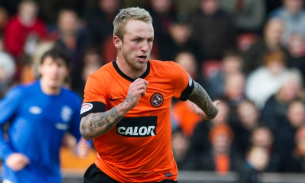 United striker Johnny Russell.