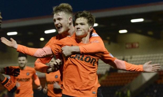 Coll Donaldson (left) congratulates goalscorer Blair Spittal.