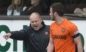 Mixu Paatelainen has words with Gavin Gunning after the incident that led to his departure from Tannadice.