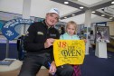 Paul Lawrie with Demi Richardson after signing her Open flag at the Scotland Home of Golf Stand.
