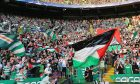 The Palestinian flag is waved by fans at Celtic Park.