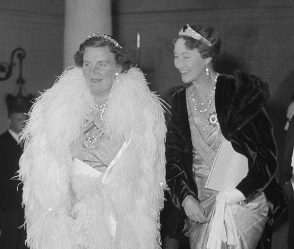Charlotte wears the Chaumet Emerald Tiara with diamonds for a theater outing during a state visit from Queen Juliana of the Netherlands, June 1951
