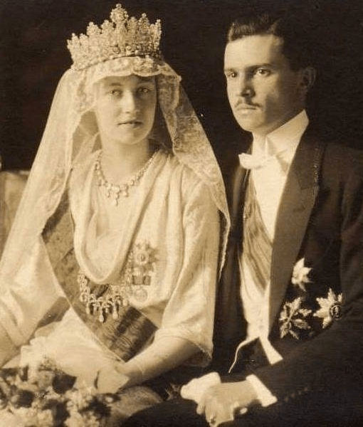Charlotte wears the Empire Tiara, a diamond necklace, and a second necklace as a corsage ornament in an official portrait from her wedding to Prince Felix of Bourbon-Parma, November 1919