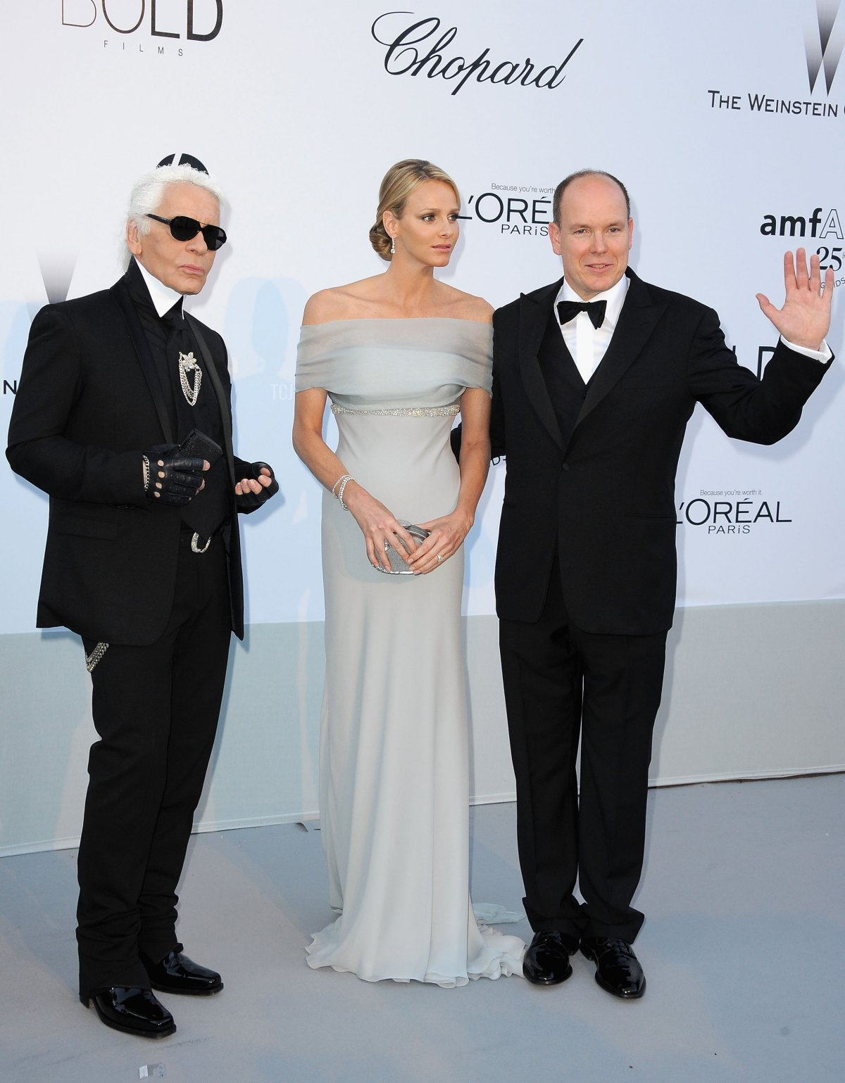 Karl Lagerfeld, Charlene Wittstock and Prince Albert II of Monaco attend amfAR's Cinema Against AIDS Gala during the 64th Annual Cannes Film Festival at Hotel Du Cap on May 19, 2011 in Antibes