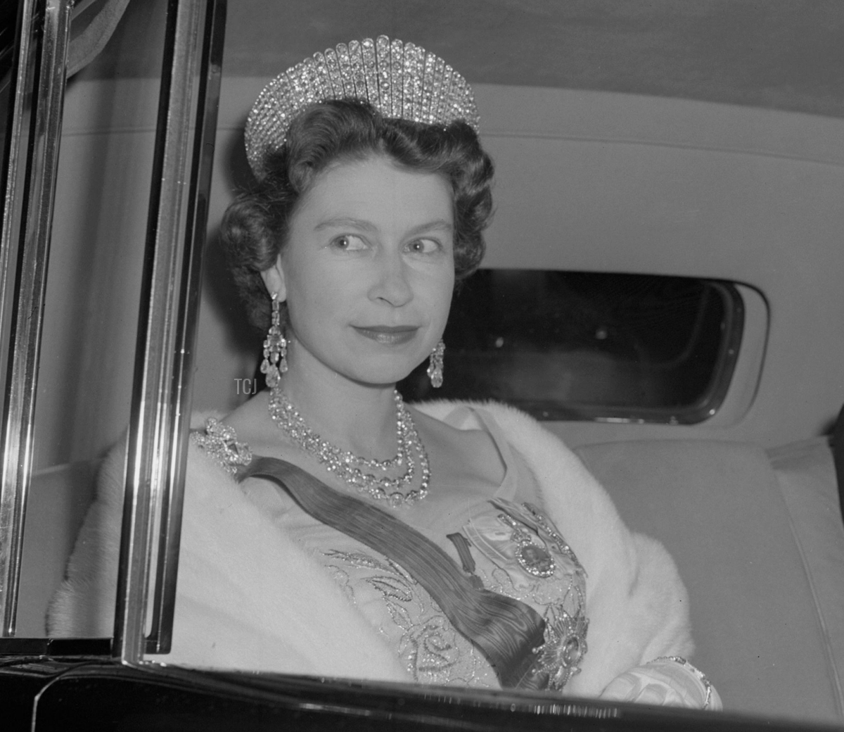 Queen Elizabeth II heads home after a dinner at the French Ambassador's residence in London, April 1960