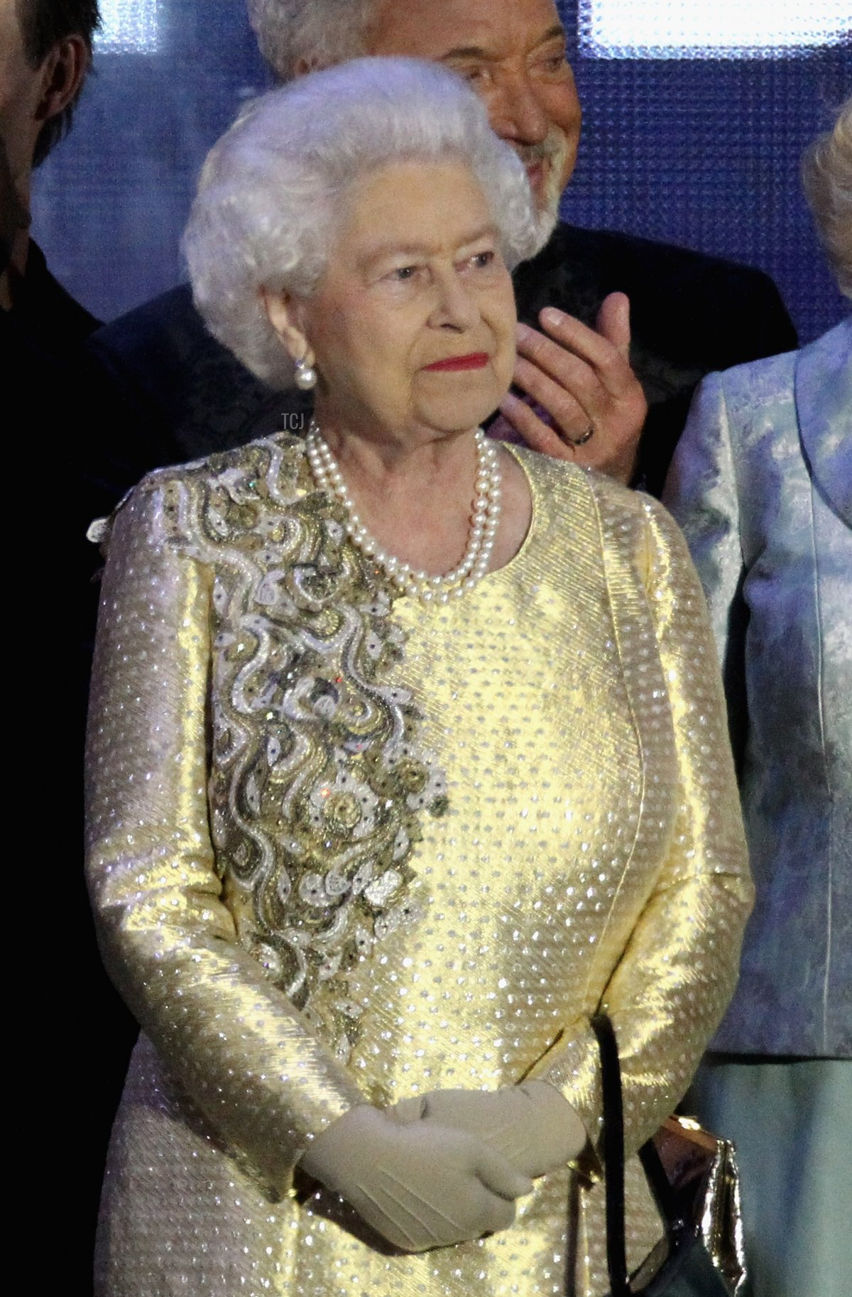 LONDON, ENGLAND - JUNE 04: HM Queen Elizabeth II on stage during the Diamond Jubilee concert at Buckingham Palace on June 4, 2012 in London, England. For only the second time in its history the UK celebrates the Diamond Jubilee of a monarch. Her Majesty Queen Elizabeth II celebrates the 60th anniversary of her ascension to the throne. Thousands of well-wishers from around the world have flocked to London to witness the spectacle of the weekend's celebrations